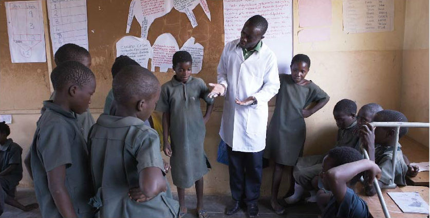 A teacher in a Catch Up classroom explains a reading activity during a TaRL class in Zambia.