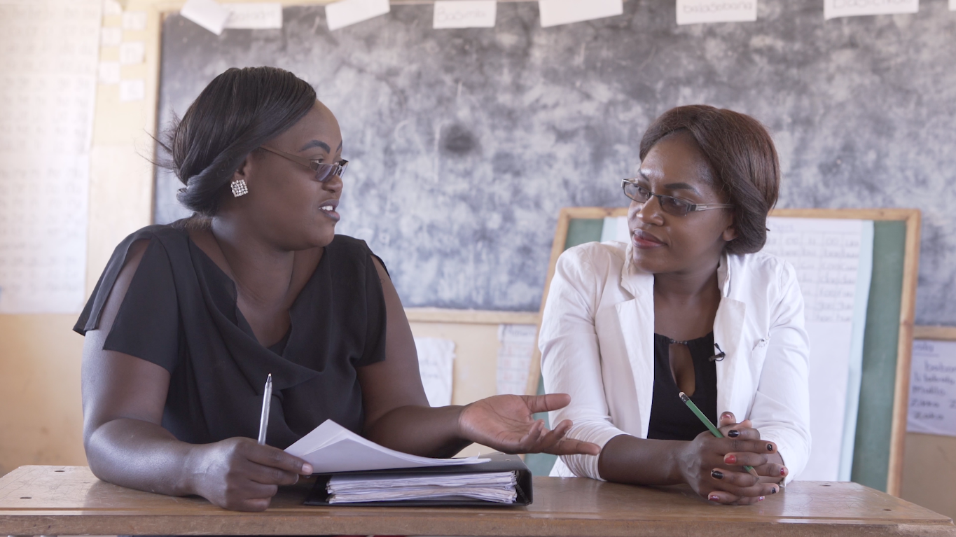 A mentor recaps the days lessons with a teacher during a Catch Up mentoring and monitoring visit in Zambia.