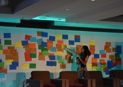 Laura Abadia from J-PAL Europe summarises participant reflections, written on colourful card.
