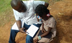 A PEC instructor assesses a child in Côte d'Ivoire