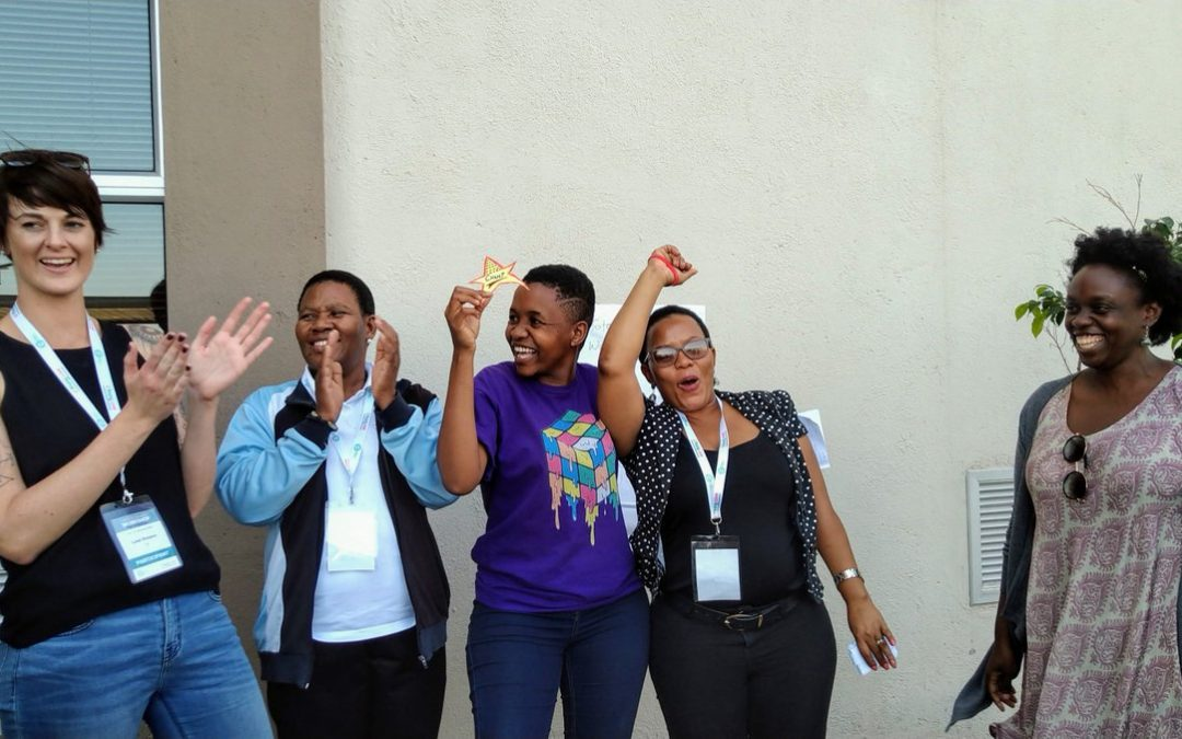 Participants celebrate at the end of an activity at the 2019 TaRL Workshop.