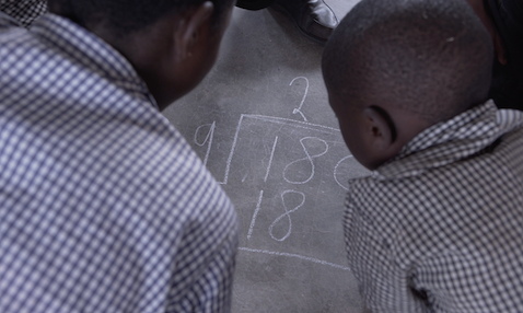 Children solve a maths sum in a TaRL class in Botswana.