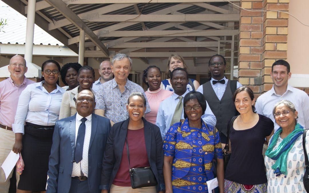 People pose for a group photo (the TaRL board, Young 1ove team, and Botswana school officials).